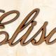 articolo-32-elisa-scritta-in-bronzo